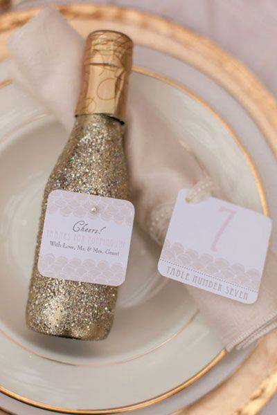 we love how this wedding played into the new year spirit with their table escort card holders being little disco balls that reminds us of the infamous one