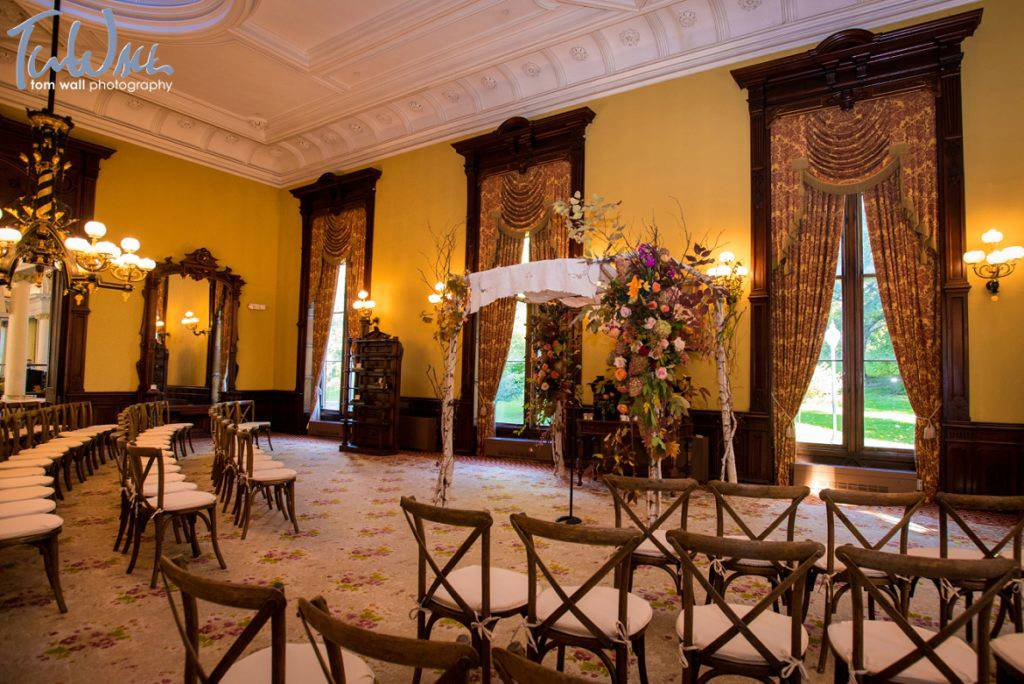 Intimate ceremony in the parlor. Chuppah and florals by Surroundings Floral Studio; ceremony music provided by All Seasons Trio.