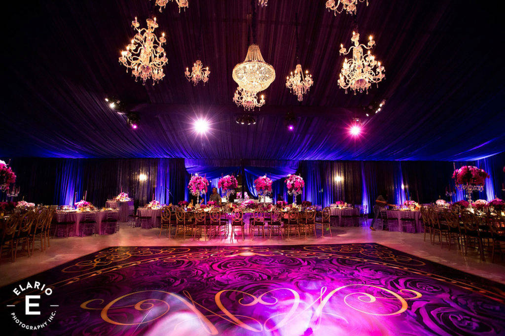 Beautiful custom dance floor, chandeliers and head table.